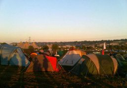 The sun setting over Glastonbury Festival 2011 on the site of Worthy…