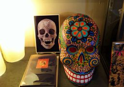 A paper mâché skull from Mexico with a photo of Damien Hirst's…
