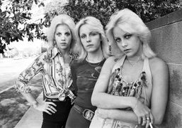 An archival photo of Cherie Curriewith her twin Marie and Vicki Razor…