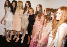 Alberta Ferretti with her models backstage after her S/S 2015 show, Milan. Photo…