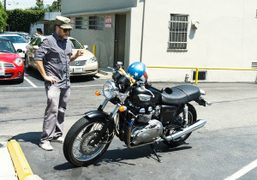 Photographer Patrick Hoelck with his new bike in Beverly Hills. Photo Andi…