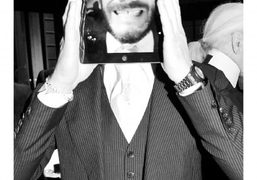 Sebastien Jondeau holding his i-Pad at Karl Lagerfeld's dinner to celebrate the launch…
