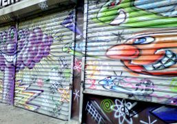 More store front graffiti by the artist Kenny Scharf on the Bowery….
