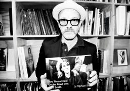 Michael Stipe holding his new book on Patti Smith at Dashwood Book…