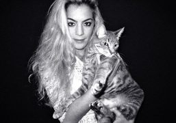 Chelsea Leyland and her catLouie at their Williamsburg home, New York. Photo…