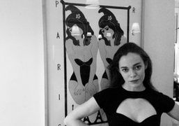 Hailey Gatesin front of a John Wesleyprint at The Paris Review's 203rd…