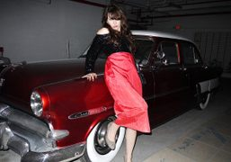 DJ and stylist Jules Wood in front of a vintage Custom Line…