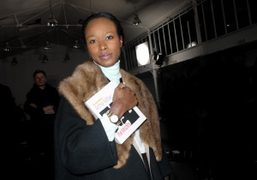 Pop magazine's editor-at-large Shala Monroque holding her Olympia Le Tan minaudière book…
