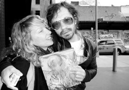 Rita Ackermann and Olivier Zahm holding Rita's new self-titled book published by…