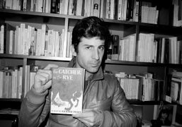 Andre Saraiva holding Catcher in the Rye by Richard Prince, a gift…