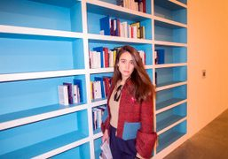 Natacha Ramsay infront of a bookshelf by Dominique Gonzalez-Foerster at the Palais…