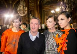 Dries van Noten with his models after his F/W 2014 show at…