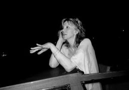 Courtney Love in a fantastic mood giving a phone call while waiting…
