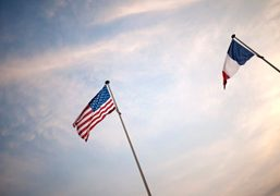 The American and French flags outside the Musée du Debarquement, Arromanches, Normandy….