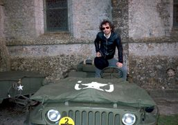 Olivier Zahm with an American army jeep parked around the church as…