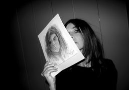 Carine Roitfeld with the portrait that Karl Lagerfeld did of her last…
