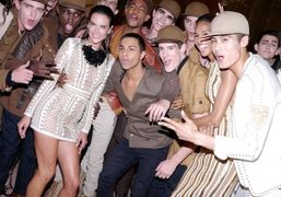 Designer Olivier Rousteing with models backstage after the Balmain Men's S/S 2016...