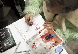 """Gary Baseman signing books at the opening of his show """"Secret Society""""…"""