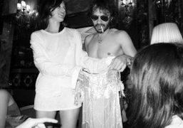 Olivier Zahm trading clothes with Milla Jovovich at the Principe di Savoia…