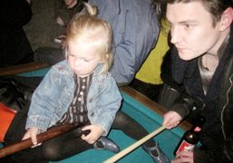 Secret Snow and Nate Lowman playing pool at the KKK show afterparty….