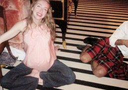 Rachel Feinstein, the most radiant pregnant woman, sitting on the floor with…