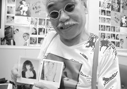 Nobuyoshi Araki holding polaroids of Olympia Le Tan and Jennifer Eyemere at his…