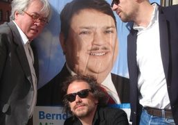 Pierre Le-Tan, Simon Liberati and Jean-Marie Delbès in front of a poster…