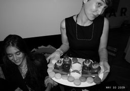 Natacha Ramsay and Sarah with Ladurée petits fours, at a dinner organized…