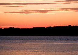 View of the sunset from the top terrace of the Sunset Beach,…