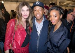 Elisa Sednaoui, Russell Simmons and Angela Simmons backstage at the Tommy Hilfiger…