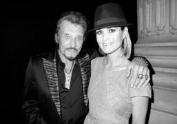 The iconic French rock star Johnny Hallyday and his wife Laeticia at Chanel's Little Black Jacket after…