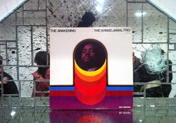 """Vintage LP on mirrored shelf at the Rashid Johnson's knockout """"Rumble"""" at…"""