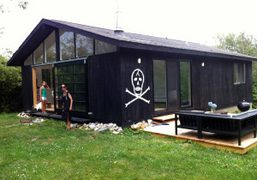 Skull and crossbones drawn by Wes Lang on Bill Powers' house in…