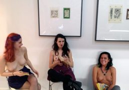 Topless girls reading Pulp Fictionat the Fulton Ryder boothat thePrinted Matter book…
