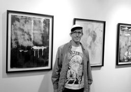 Kadar Brock in front of his works on paper on view until…