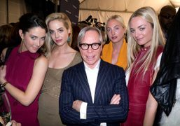 Tommy Hilfiger and the Courtin-Clarins sisters backstage at the Tommy Hilfiger F/W 2012…