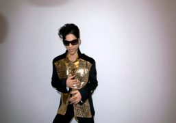 Prince at the Yves Saint Laurent Spring Summer 2010 collection, Paris. Photo…