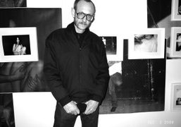 Terry Richardson in front of his portrait in my photo show, Half…