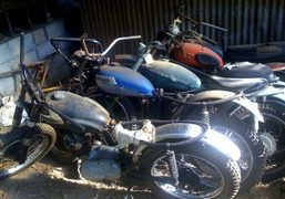 A graveyard of old Triumph Cub motorcycles, Los Angeles. Photo Dustin A….