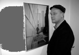 The interior designer Ricky Clifton in front of a Luigi Ontani photograph…