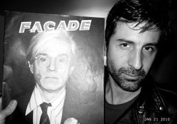 André with an issue of Façade at André & Lionel's apartment with…