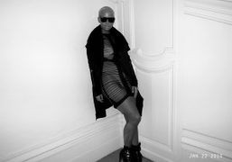 Amber Rose at the Yves Saint Laurent F/W 2010 Men's show wearing…