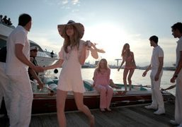 Models arriving on Riva yacht at the 2011Chanel Cruise show on the…