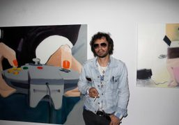 In front of an installation of Miltos Manetas paintings at the Purple…