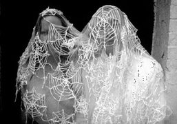 Kembra Pfahler and Terence Koh caught in a spiderweb at Tea and…