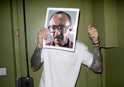 Terry Richardson holding his portrait by Mario Sorrenti at Purple Institute, Paris….