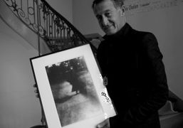 The art director and curator Eric Pfrunder holding the favorite picture from…