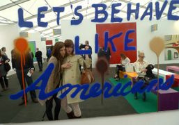 Ben Grimes and Paula Goldstein, in front of a Sam Durant work…