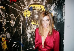 Carine Roitfeld standing in front of a Nicolas Pol artwork at the…