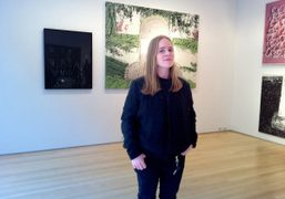 Hanna Liden in front of Nate Lowman's Erection painting at their Salon…